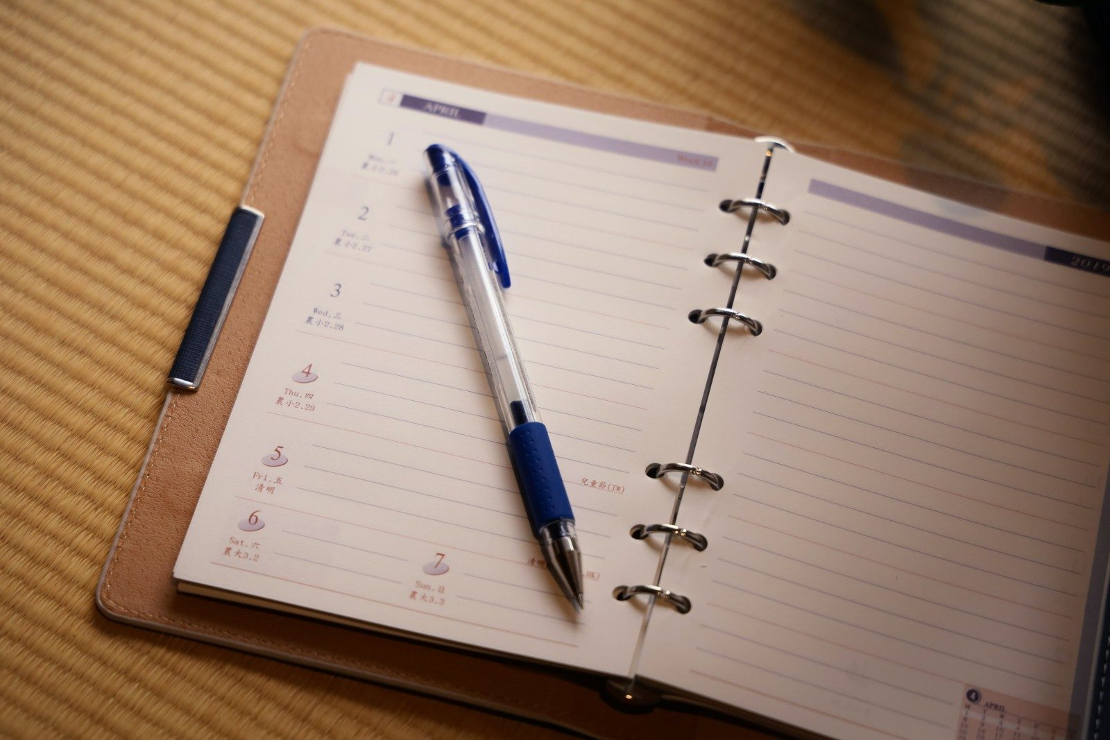 blue click pen on white ruled paper